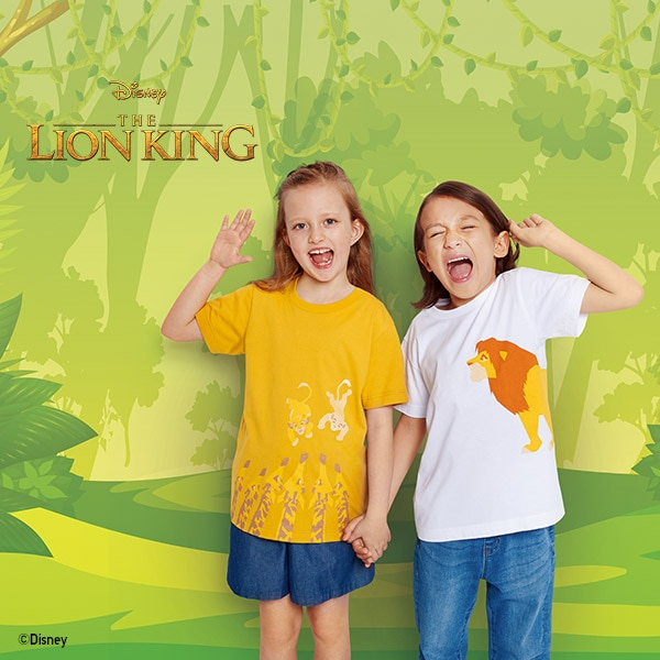 Two children roar like Simba wearing The Lion King Collection T-shirts in bright yellow and classic white