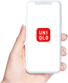A hand holding an iPhone displaying the UNIQLO logo