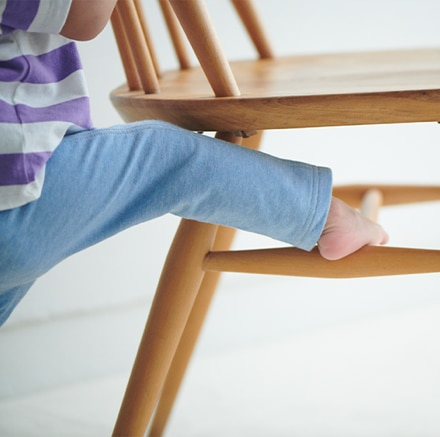 Toddler climbing on a chair
