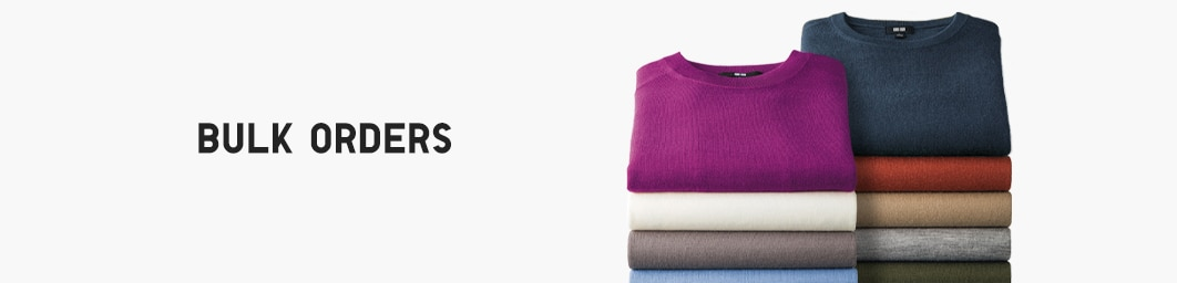 image of sweaters stacked up